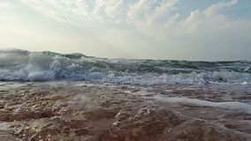 Diving in coming waves stock video footage