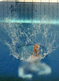 Diving competition. Swimmer launched into water in a diving competition Stock Image