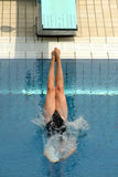Diving competition. Swimmer launched into water in a diving competition Stock Photography