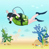 Diving. Dive to the seabed diving. The depth of the sea. Stock Photo