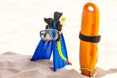 Diving equipment on beach. Blue and orange Royalty Free Stock Photography