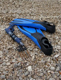 Diving equipment (fins, harpoon). Diving equipment(fins, harpoon) on stone beach Stock Images