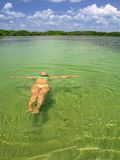 Diving girl. Woman swimming in the lagoon. Brazil Stock Photos