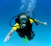 Diving girl. Underwater shot of girl diving with aqualung Stock Photography
