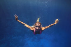Diving girl. Beautiful blonde girl dive underwater in Red Sea Stock Photo