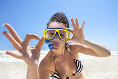 Diving girl in a swimming mask. Happy diving girl in a swimming mask and snorkel showing okay sign. Funny picture royalty free stock photos