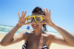 Diving girl in a swimming mask and snorkel. Happy diving girl in a swimming mask and snorkel stock photos