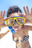 Diving girl in a swimming mask and snorkel Royalty Free Stock Photography