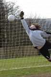 A Diving goalkeeper missing a save !! Stock Images
