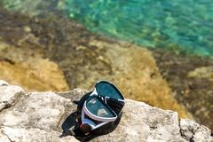 Diving goggles on the beach Stock Photography