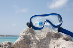 Diving goggles on the rock Royalty Free Stock Image