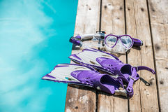 Diving goggles, snorkel and fins on the jetty Stock Photography