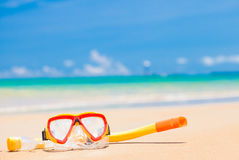 Diving goggles and snorkel gear on sandy beach Stock Image