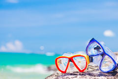 Diving Goggles and Snorkel Gear stone near beach Stock Image