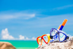 Diving Goggles and Snorkel Gear stone near beach Stock Photo