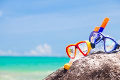 Diving Goggles and Snorkel Gear stone near beach Stock Images
