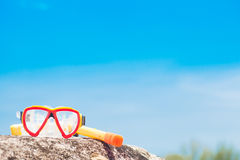 Diving Goggles and Snorkel Gear stone near beach Royalty Free Stock Images
