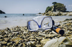 Diving Goggles and Snorkel Gear on stone at sunny day Stock Images