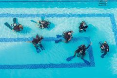 Diving instructor and students. Instructor teaches students to d stock image