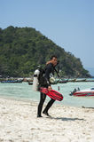 A diving instructor walking passed by Royalty Free Stock Image