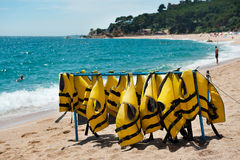 Diving jackets at the beach Stock Photos