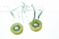 Diving kiwi fruit. Two kiwi fruits falling into the water Royalty Free Stock Images