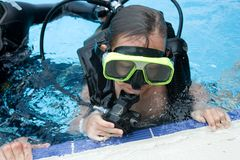 Diving lesson in pool stock image