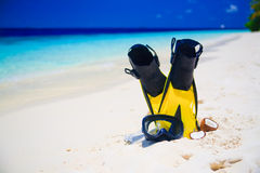 Diving Mask with fins on beach Royalty Free Stock Photo