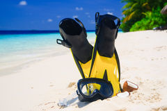 Diving Mask with fins on beach Stock Photo