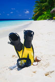 Diving Mask with fins on beach Royalty Free Stock Photos