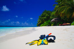 Diving Mask with fins on beach royalty free stock images