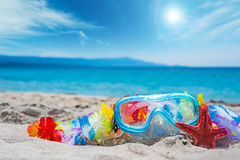 Diving mask and red sea star on the beach Stock Photography