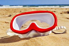 Diving mask in the sand of a beach Stock Photo