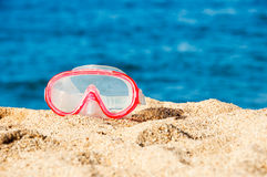 Diving mask on the sand of a beach Royalty Free Stock Photos