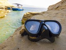 Diving mask for scuba diving on the rock near the sea.  royalty free stock photo