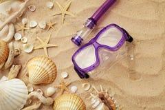 Diving mask, seashells and sand. Summer background. seashells and diving mask on sand Stock Image