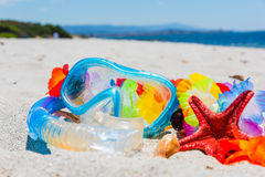 Diving mask and snorkel on the beach. In the summer Royalty Free Stock Photo