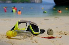 Diving mask and snorkel on the beautiful beach. Sand coral and brurred background Royalty Free Stock Photos