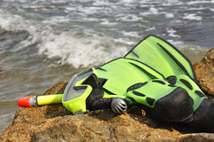 Diving mask, snorkel and flippers. On seacoast. Equipment for diving Royalty Free Stock Photos