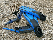 Diving mask, snorkel, harpoon and fins. On stone beach Stock Photography
