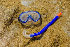 Diving Mask with Snorkel. On sand beach. Summer recreation accessories Stock Photography