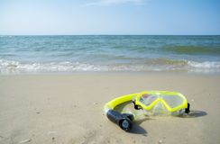 Diving mask and a snorkel on the sand of a beach Stock Images