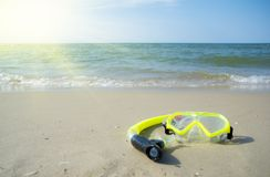 Diving mask and a snorkel on the sand of a beach Royalty Free Stock Photos