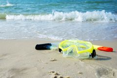 Diving mask and a snorkel on the sand of a beach Royalty Free Stock Images