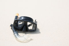 Diving mask and snorkel on sand at phuket thailand beach. Diving mask and snorkel on sand at phuket thailand beach Royalty Free Stock Photos