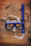 Diving mask and snorkel on wood Royalty Free Stock Images