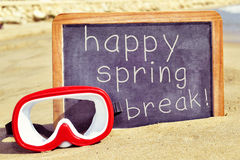 Diving mask and text happy spring break in a chalkboard Royalty Free Stock Photography