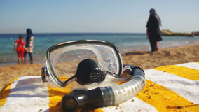Diving Mask with a Tube for Snorkeling Lying on a Lounger on the Background of the Red Sea Beach in Egypt stock footage