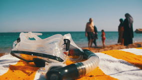 Diving Mask with a Tube for Snorkeling Lying on a Lounger on the Background of the Red Sea Beach in Egypt. Exotic beach. Relax video. Sun Loungers Near To Sea stock video footage