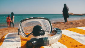 Diving Mask with a Tube for Snorkeling Lying on a Lounger on the Background of the Red Sea Beach in Egypt. EGYPT, SOUTH SINAI, SHARM EL SHEIKH, DECEMBER 7, 2016 stock footage